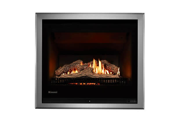 Rinnai 750 gas fireplace with logs and silver surround